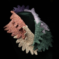 Knitted collar by the Village Knitiot, Barbara Henryt